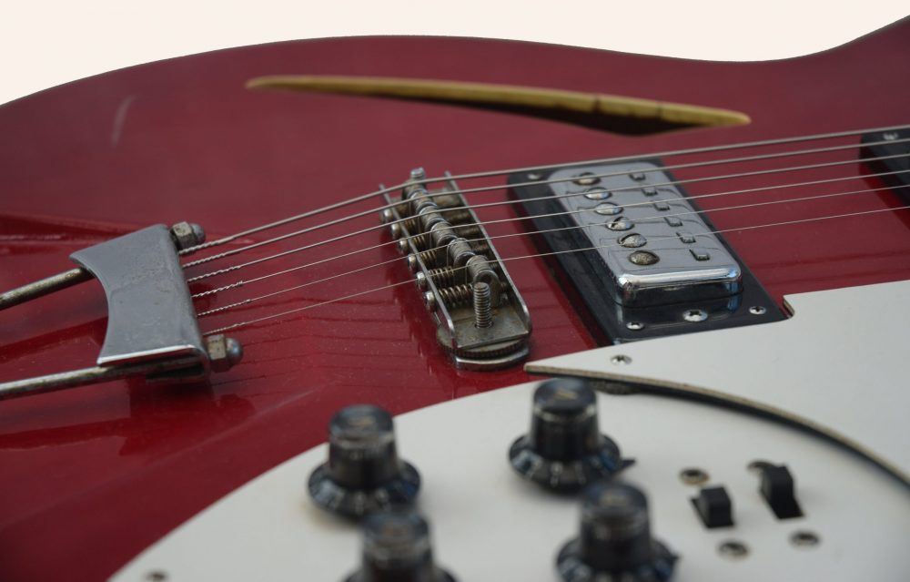 Photo contains the vintage guitar seen from the bridge