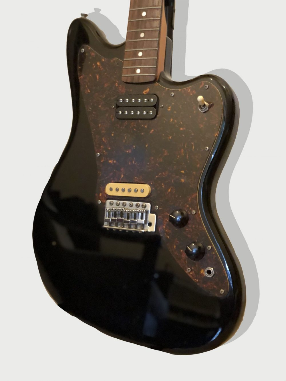 Squier by Fender, Jagmaster electric guitar. Black body, rosewood neck