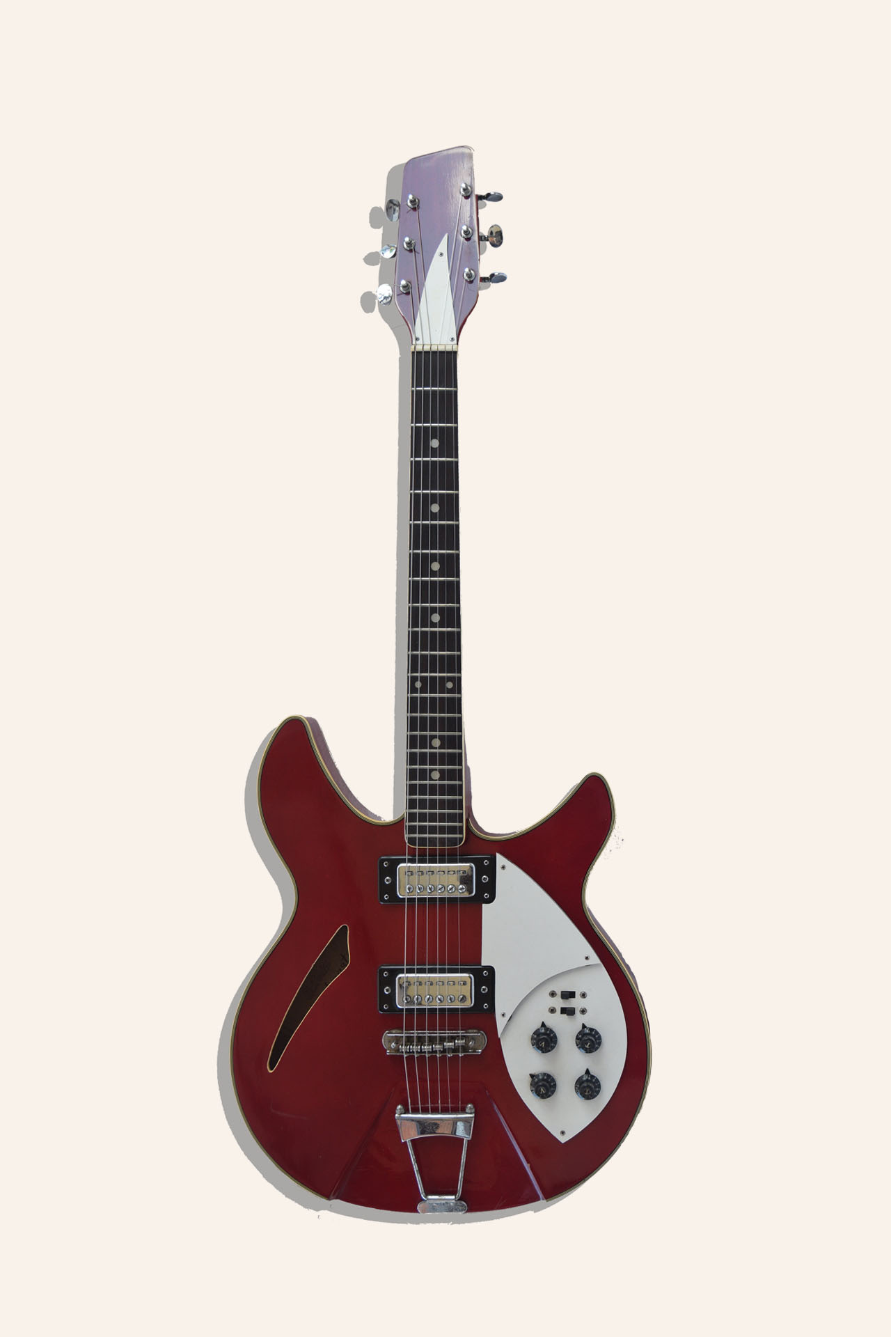 The Photo contains a vintage Japanese guitar made in 70s